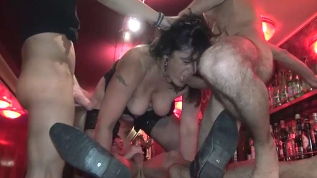 French mature Nathalie gangbanged in a pub